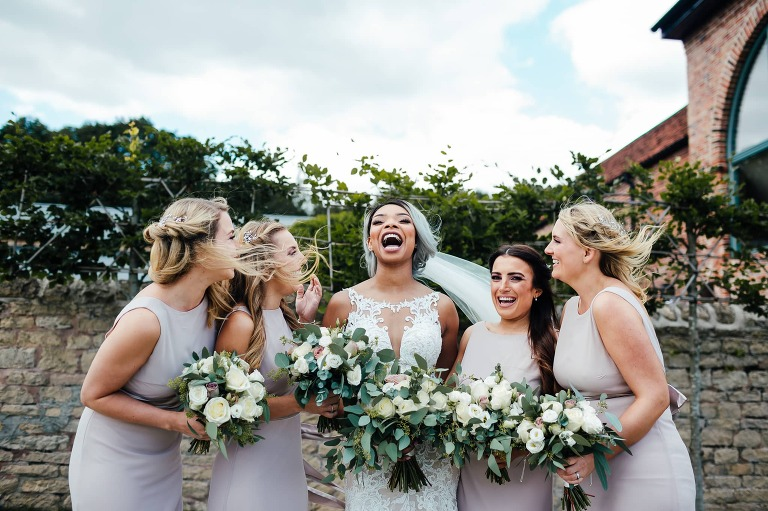 Hazel gap barn wedding. Bride and bridesmaids laughing