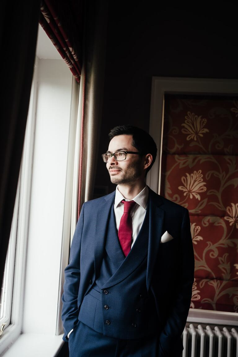 Wedding at West Bridgford Registry Office: Portraits of groom in the window light