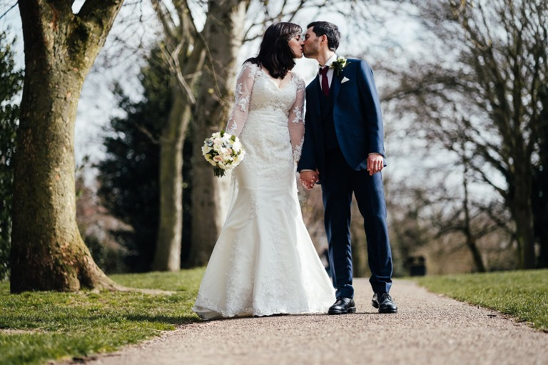 Wedding at West Bridgford Registry Office: Couple portrait in the park. Kissing